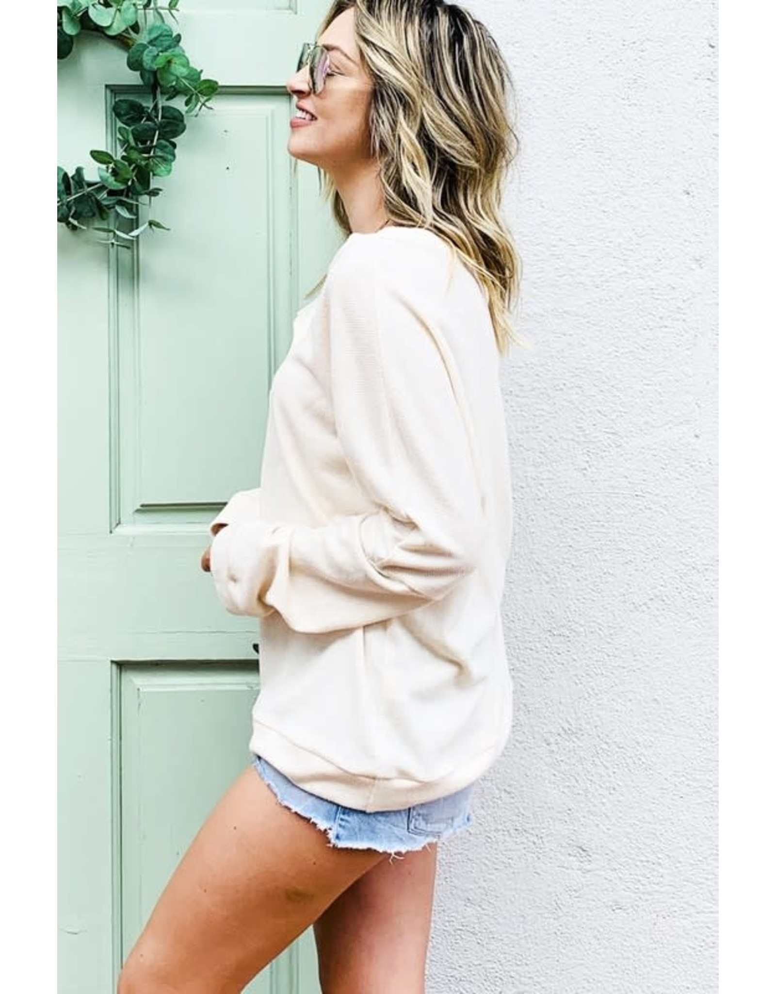 AND THE WHY CREAM BASIC KNIT TOP WITH WOOD BUTTON DOWN