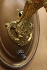 Pair of 1930's brass gilt cast wall sconces, with metal pendants