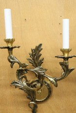 Pair of vintage brass wall sconces with sculpted crossed leaves motif