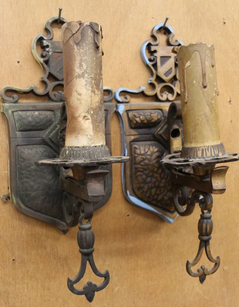 Pair of cast wall sconces, with heraldic shield and bellflower motif