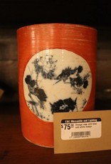 Orange vase with blue and white design