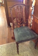 Chair, wooden, carved back, turned front legs with wheels, blue upholstered seat
