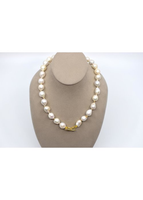 Catherine Canino Baroque white freshwater pearl strand hand knotted necklace with toggle and ring clasp
