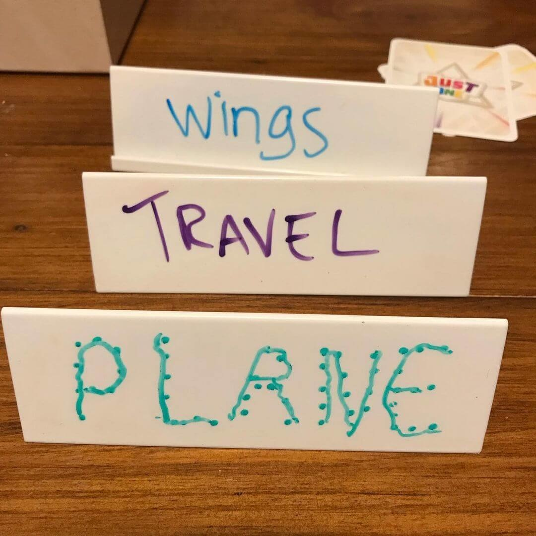 Just One board game being used for kindergarten writing practice
