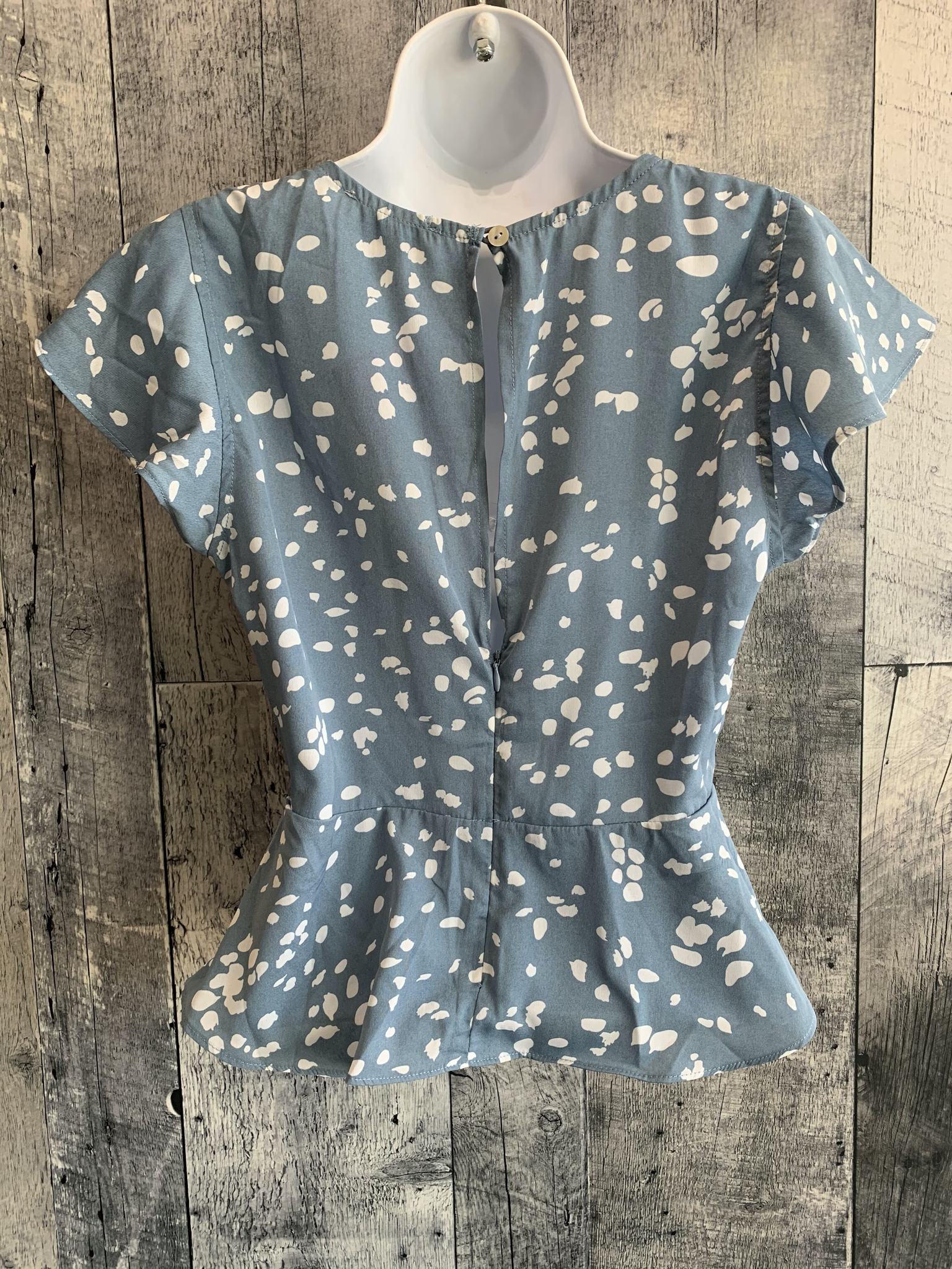 spotted peplum button top