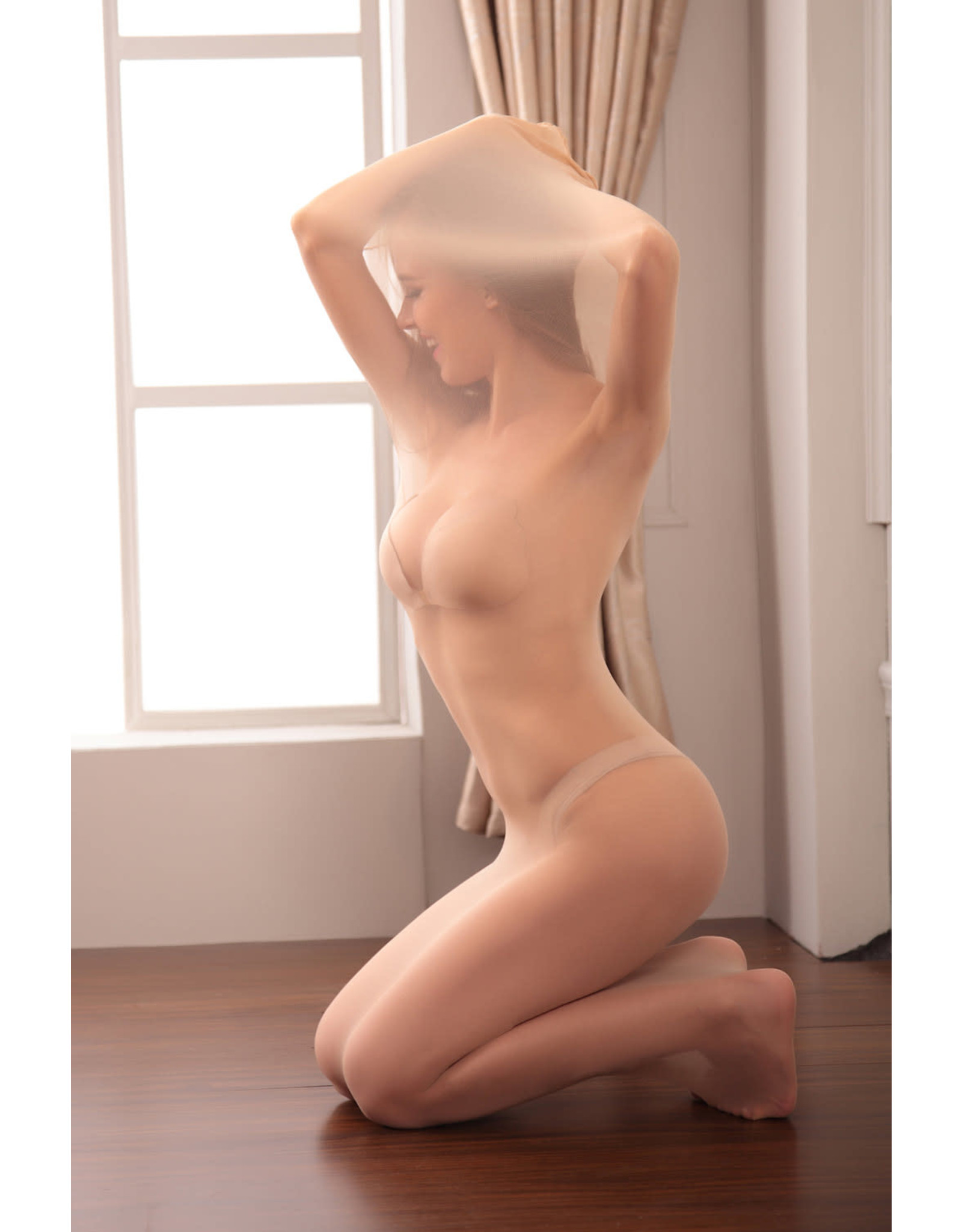 CAGED IN NYLON NUDE