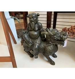 Bronze Wise Man Riding Dragon