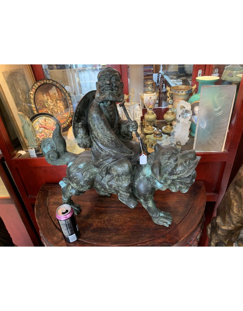 Bronze Man Riding Foo Dog