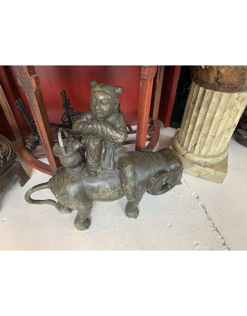 Bronze Woman Riding Elephant