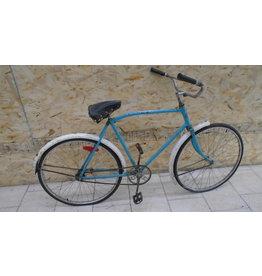Vélo usagé antique bleu