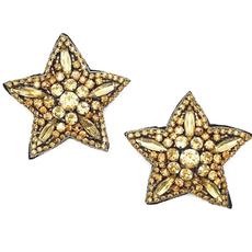 Statement star studs: gold