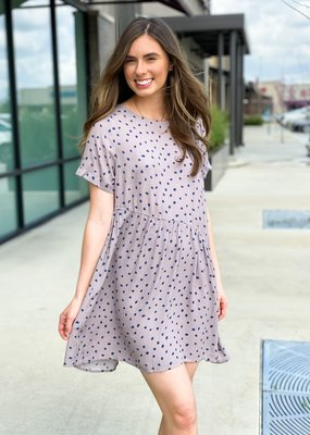 Dress with Polka Dots and Asymmetrical Bottom