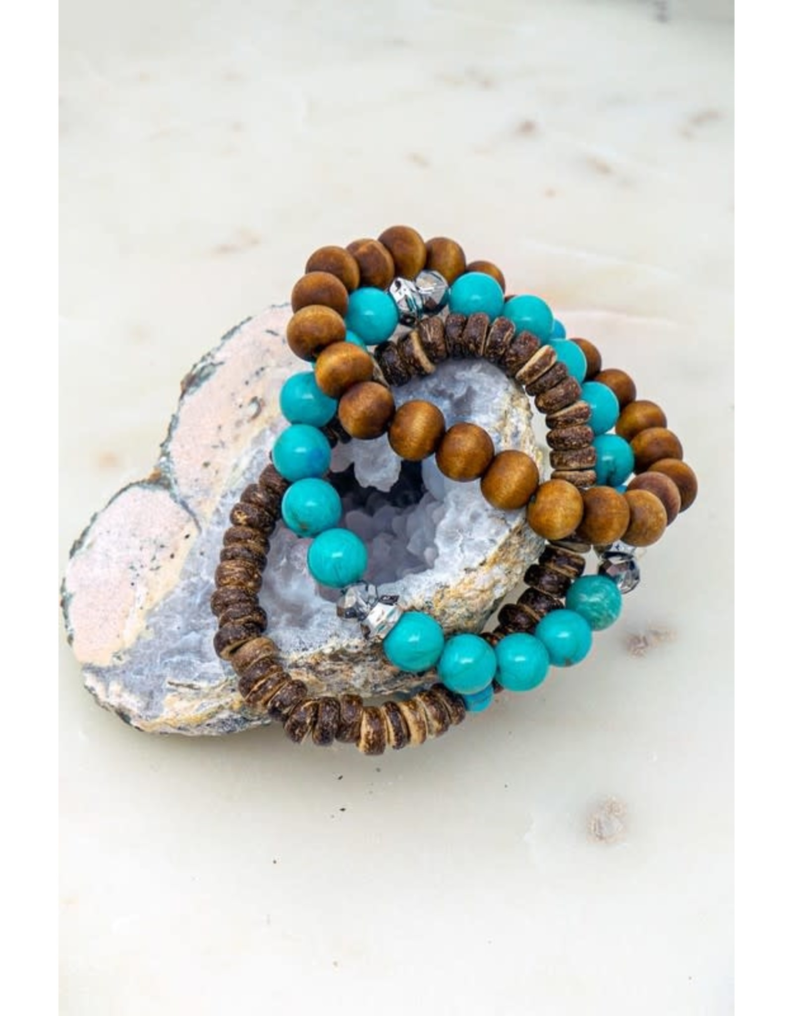 Wear separately or together these three bracelets feature wooden and turquoise colored beads. Size + Fit Diameter: 2.25 In. Different Wooden And Turquoise Beaded Bracelets - Color: Brown
