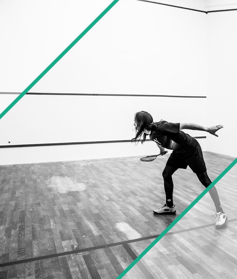Squash Player Hitting Ball