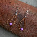Elizabeth George earrings with beads woven cedar