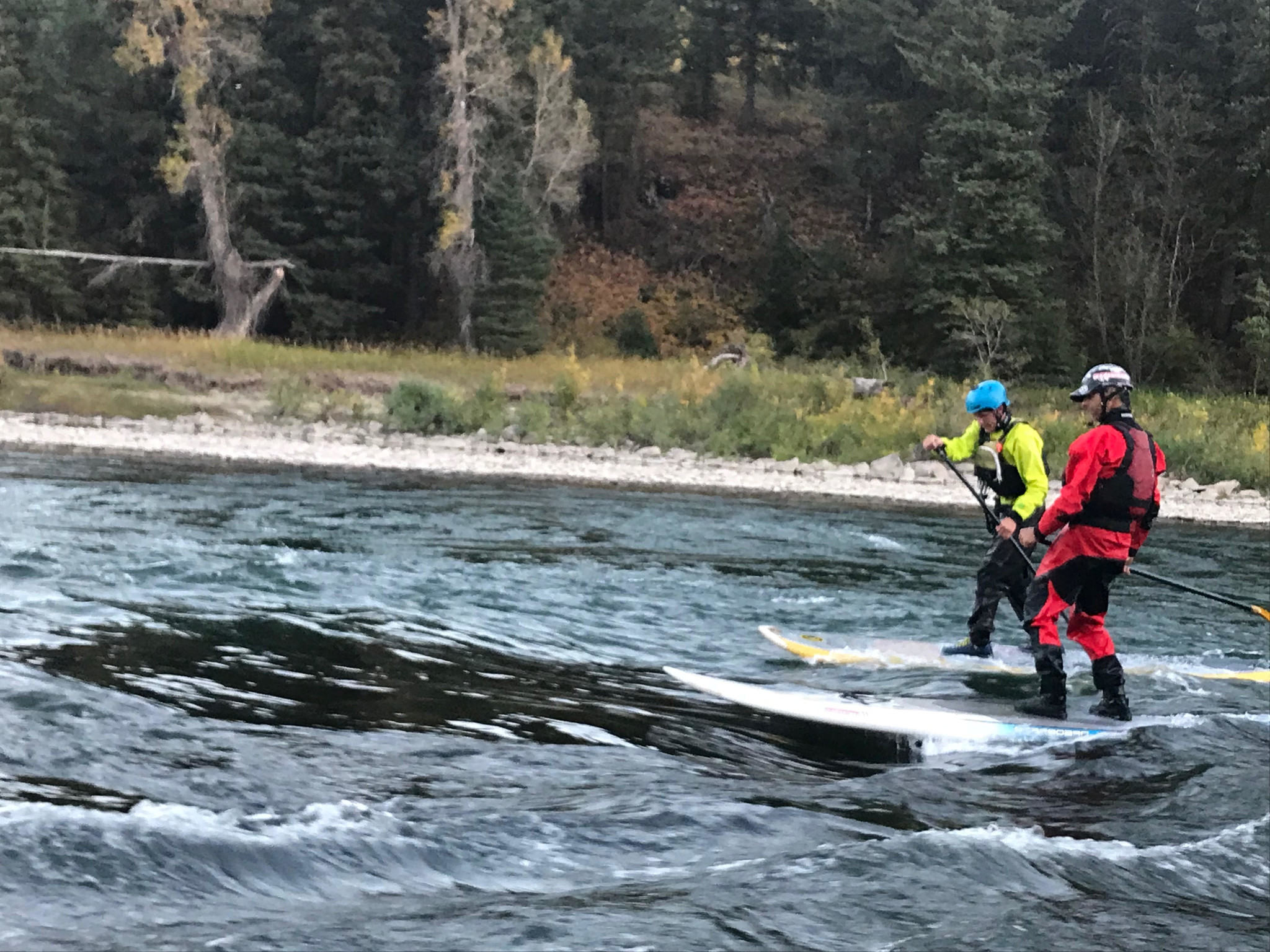 Owner Aaron Pruzan and Employee Porter Bankhead Surfing on the Snake River Jackson, WY