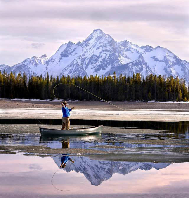 Fishing off a Canoe with Tetons in view