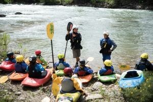Aaron teaching kids on the river