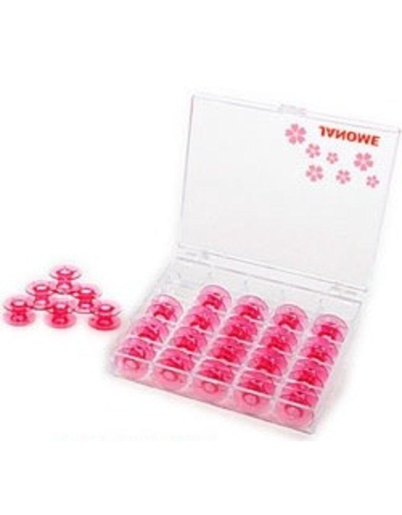 Janome 25 pink bobbins in display case