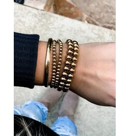 Relish Stainless Steel Gold Ball Bracelet