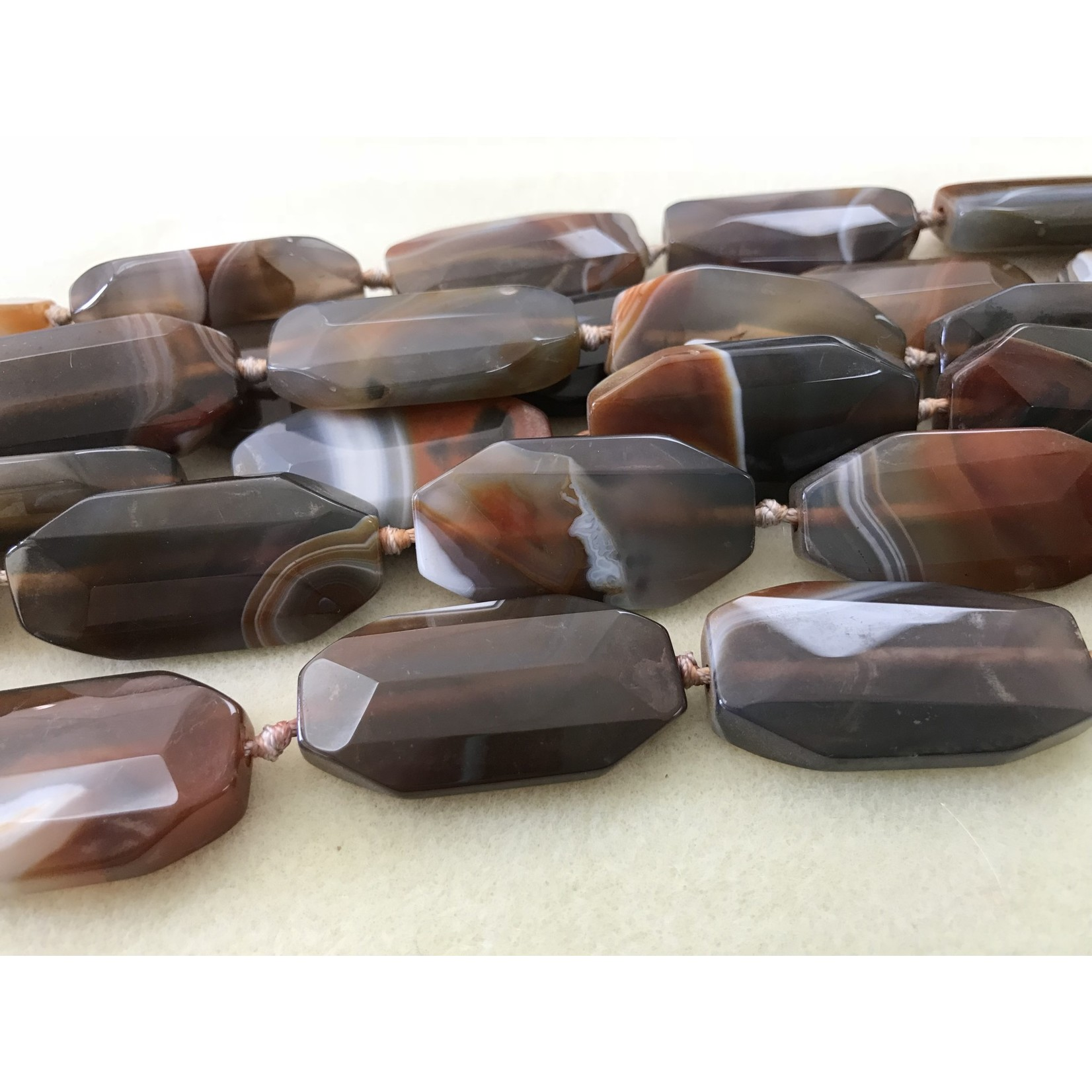 Brazilian AGATE 42x22mm Faceted Oval 1/2 Strand