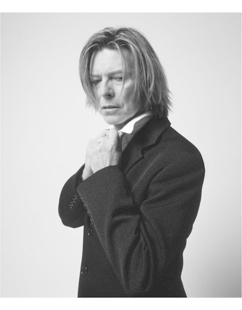 Rock Bowie in Black Jacket Looking Down, NYC, 2002 by Mick Rock