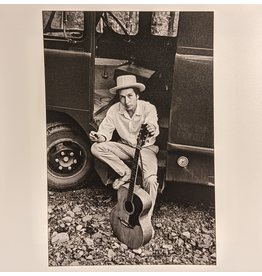 Magnum Bob Dylan, sitting on his equipment truck, Woodstock, New York, USA, 1968 by Elliot Landy
