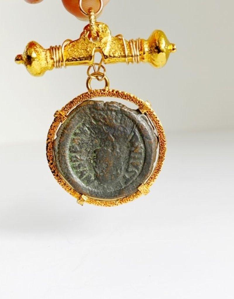 "SENNOD Roman ""M"" Coin on Roman Bar Vignette"