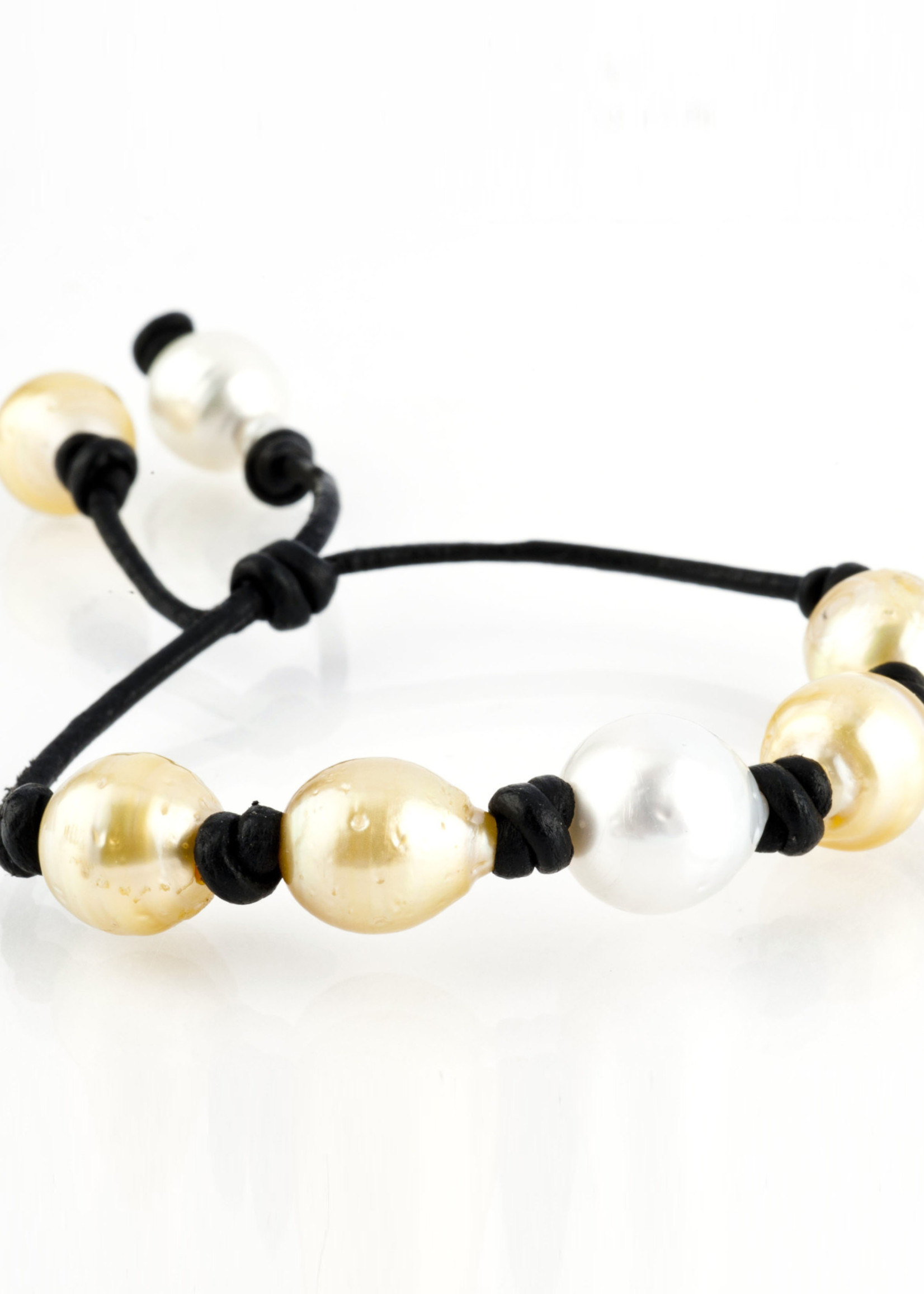 Mina Danielle Yellow and White South Sea and Tahitian Pearl Bracelet on black leather Cord with adjustable sliding closure.