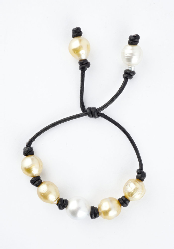 Yellow and White South Sea and Tahitian Pearl Bracelet on black leather Cord with adjustable sliding closure.