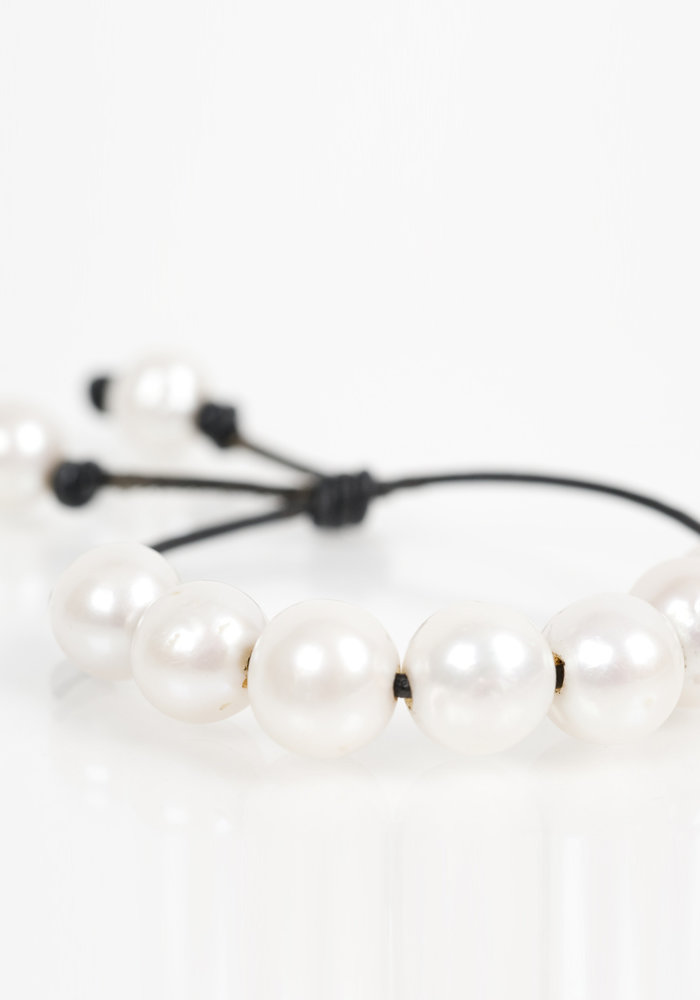 White Fresh Water Pearls on Black Leather Cord