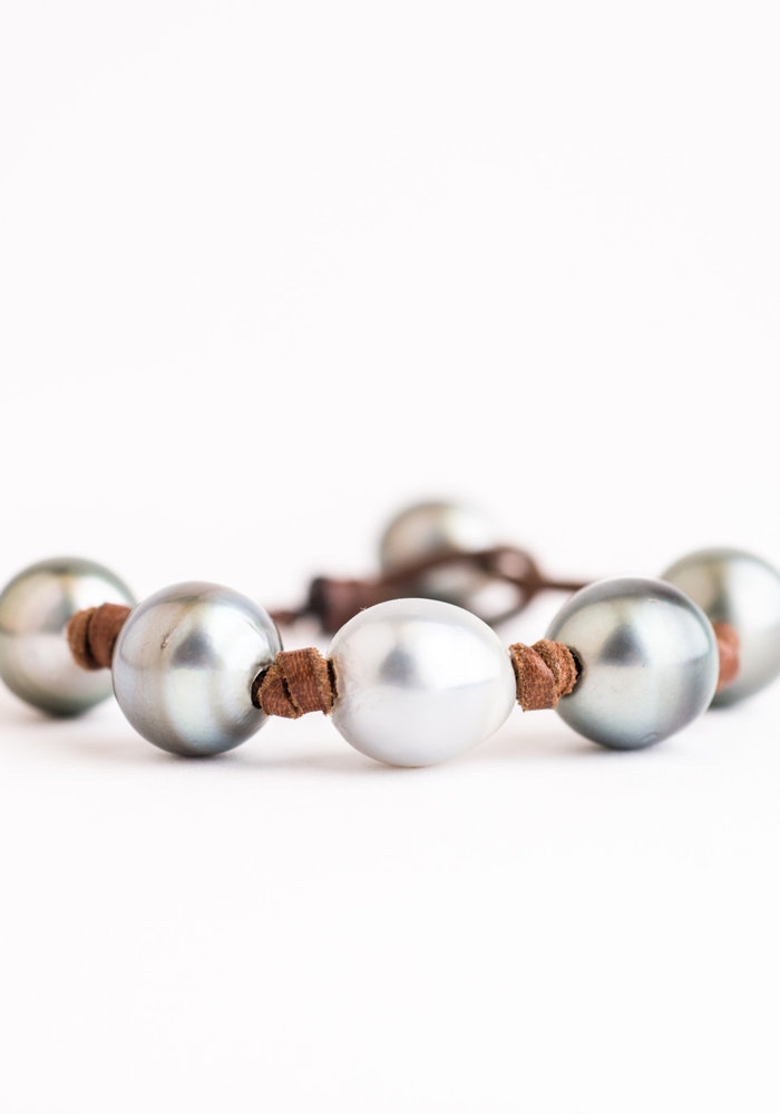 Light Gray Tahitian and White South Sea Pearls knotted on Natural Leather Cord. Pearl Button Closure.