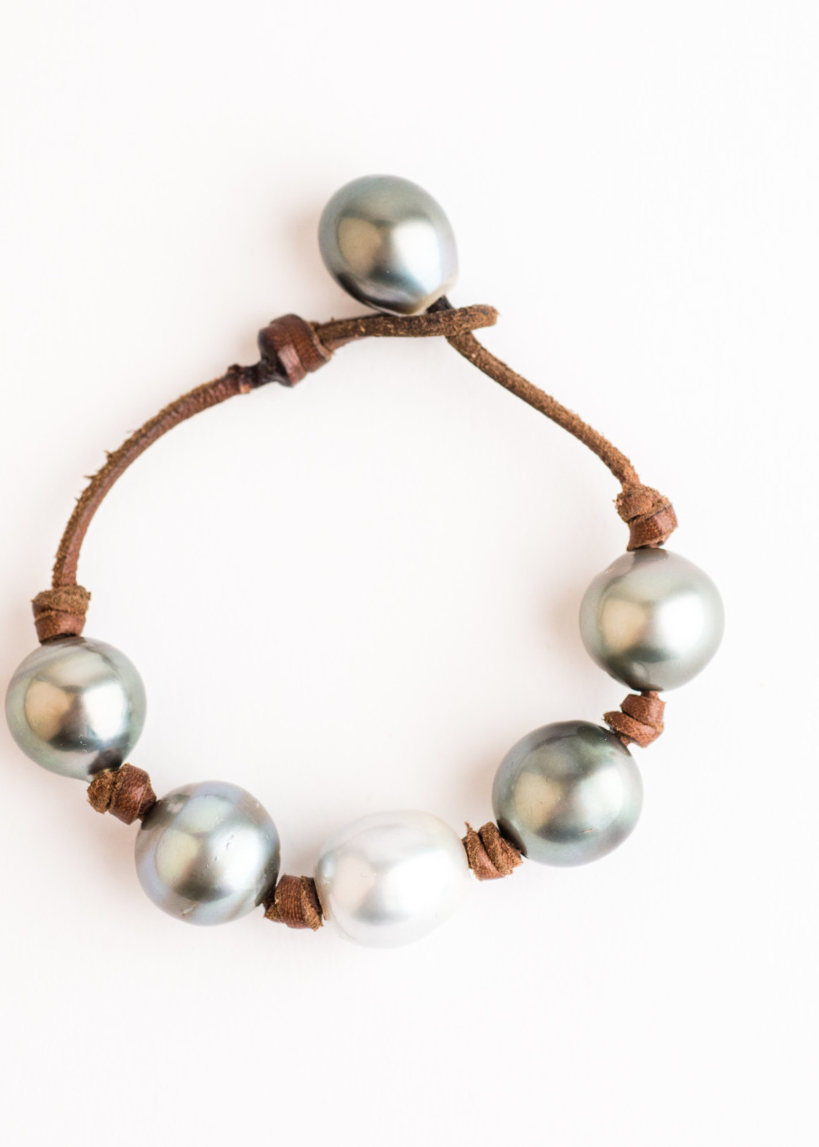 Mina Danielle Light Gray Tahitian and White South Sea Pearls knotted on Natural Leather Cord. Pearl Button Closure.