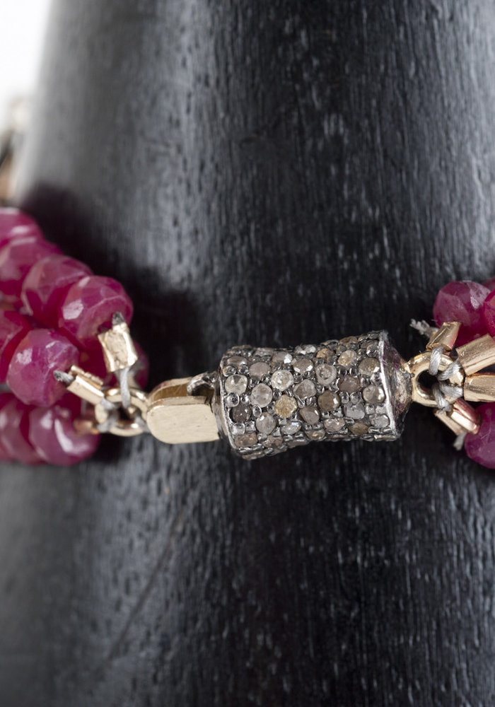 One of a kind Ruby and Emerald Diamond Brooch Bracelet. Three rows of Ruby Gemstones are strung on each side of the Brooch and finished with a Beautiful Diamond Clasp. This piece can make any outfit.