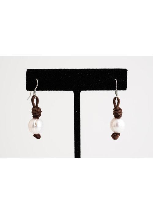 Mina Danielle White Pearl Earrings on Brown Leather
