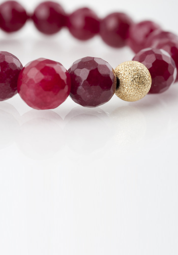 Faceted Ruby with Gold Stardust