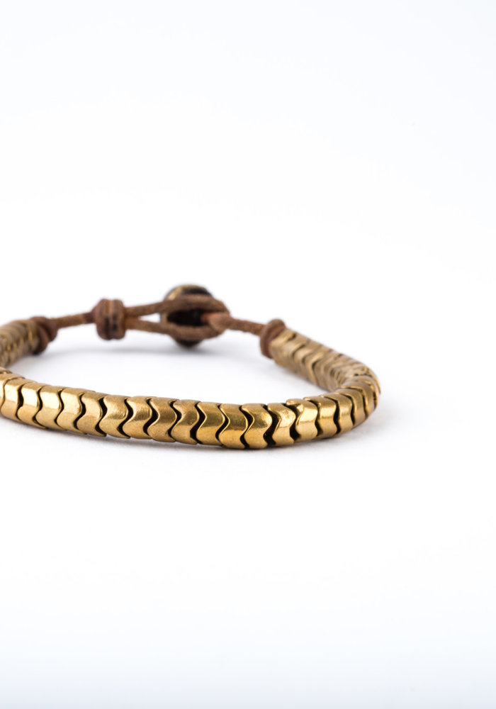 African Snake Vertebrae on brown leather cord with Pearl button closure.