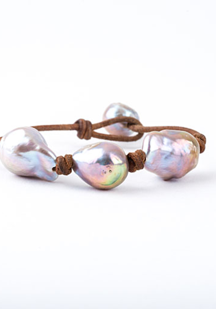3 Pink Baroque Pearls knotted on Tan Leather cord. Pearl Button Closure