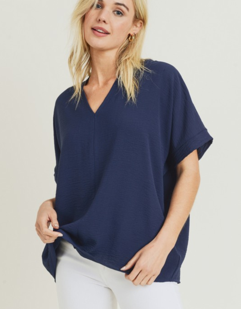 Red Door Navy v neck top with cuffed sleeves
