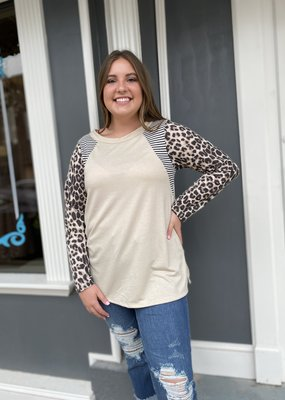 Red Door Oatmeal top with leopard sleeves and striped shoulders