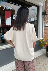 Red Door V-neck top with cuffed sleeve