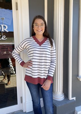 Red Door Ivory v-neck sweater with black stripes and rust detailing
