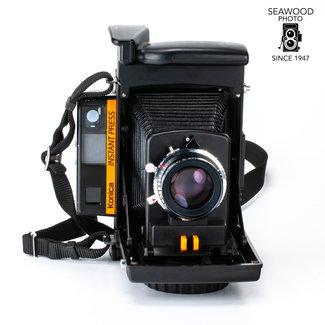 Konica Konica Instant Press Instant Film Rangefinder w/Hexanon 110mm F4 GOOD