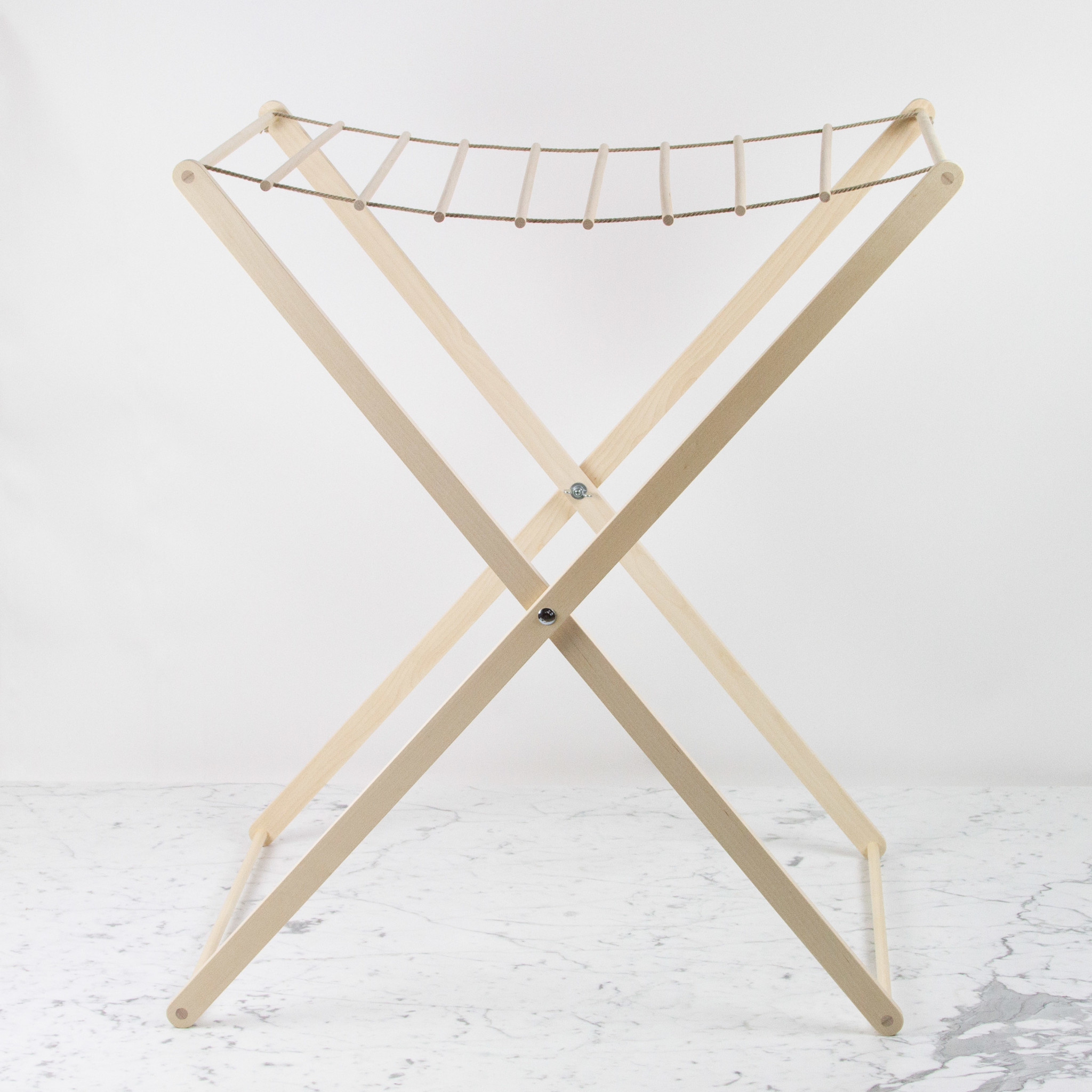 Iris Hantverk A gorgeous and ingeniously simple Swedish foldable drying solution.