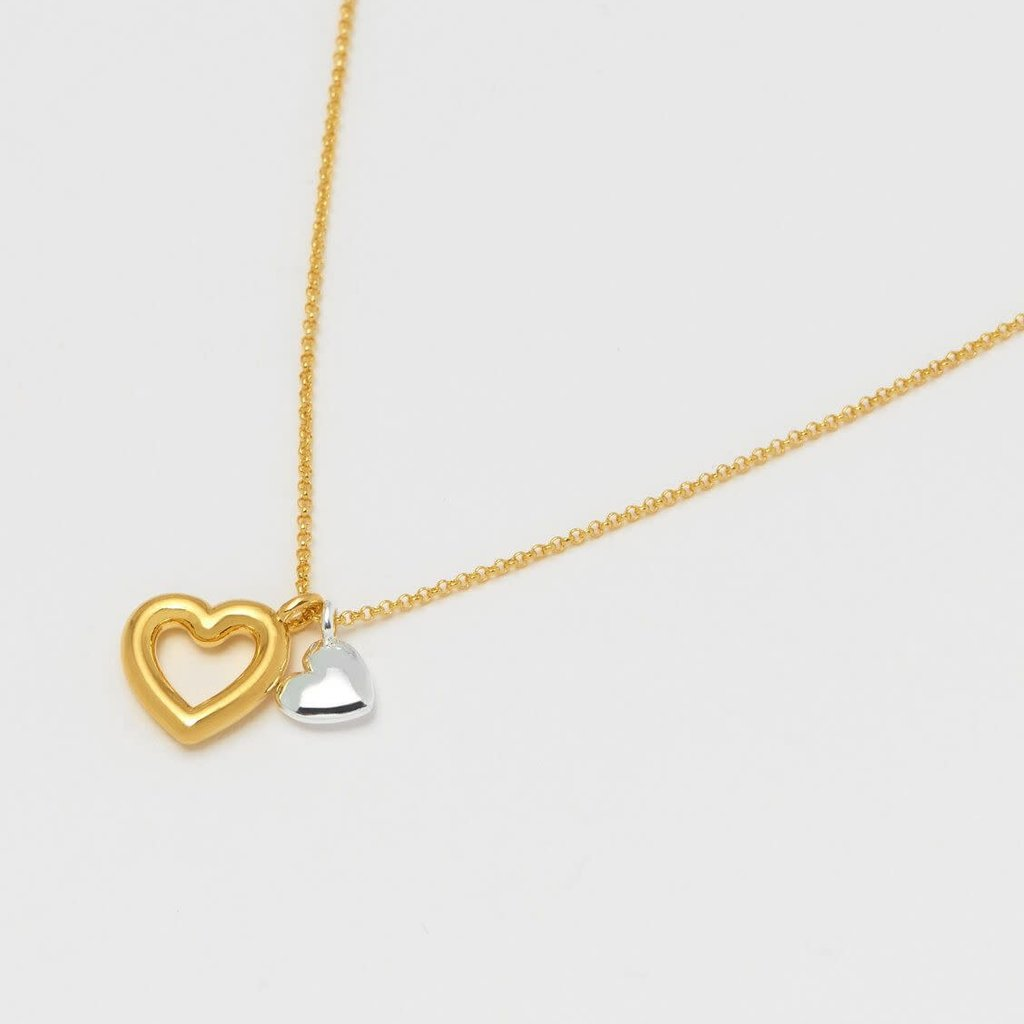 ESTELLA BARTLETT DOUBLE HEART CHARM NECKLACE - YELLOW GOLD AND SILVER