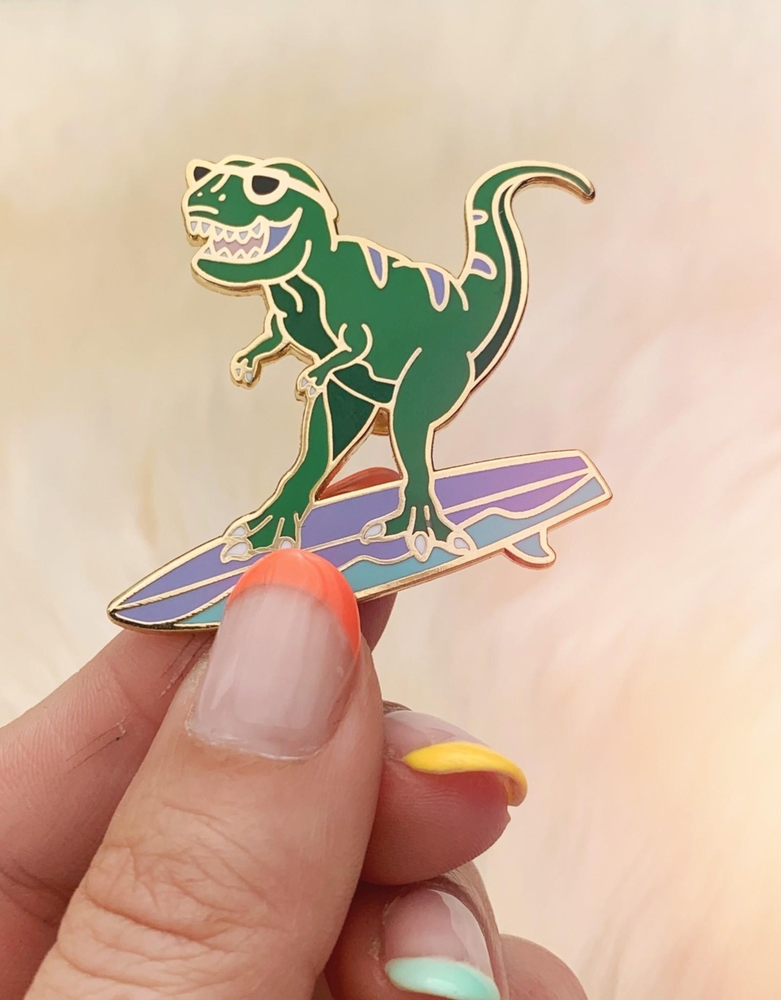 Wildflower + Co Surfing T-Rex Enamel Pin