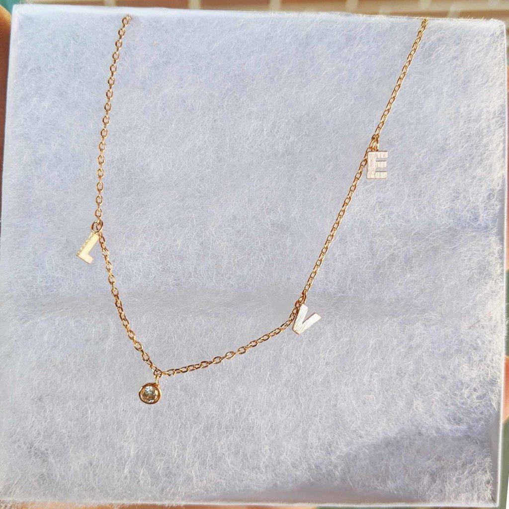 """Fame Accessories L-O-V-E Spells """"Love"""" Necklace - Gold Tone"""
