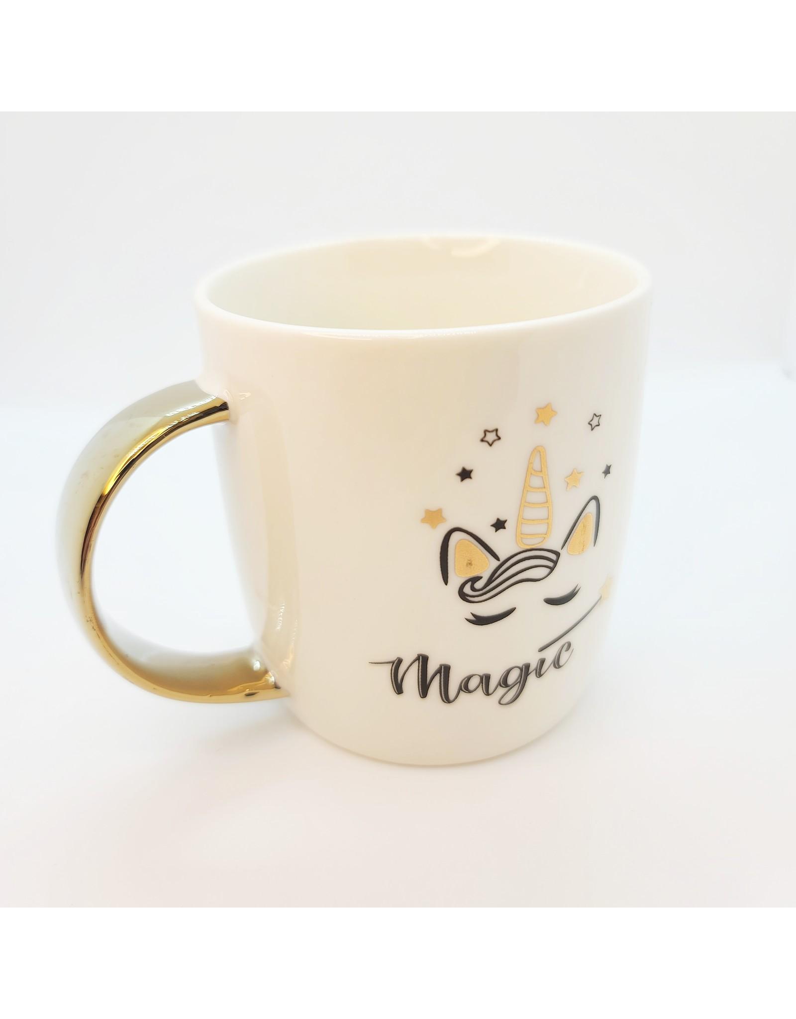 Tasse à anse dorée magique