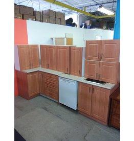 "Studio District Light brown ""L"" shaped kitchen"