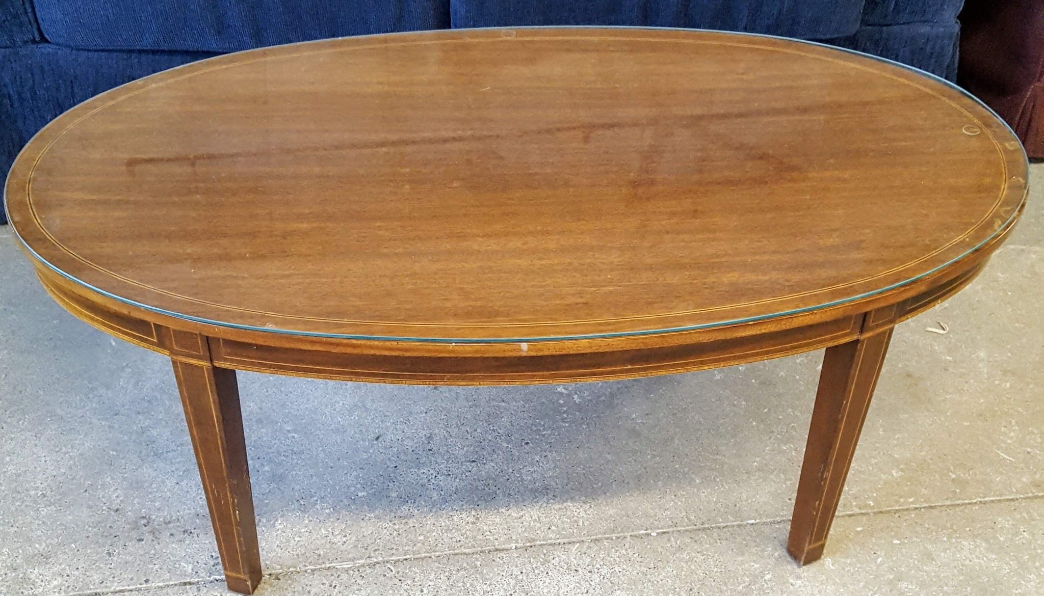 Picture of: Oval Glass Top Coffee Table Habitat For Humanity Restore